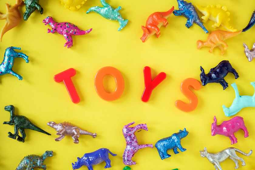 assorted plastic toy on yellow surface