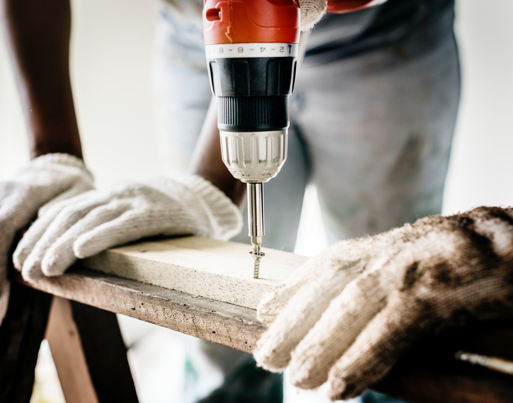 repairman doing screw drilling