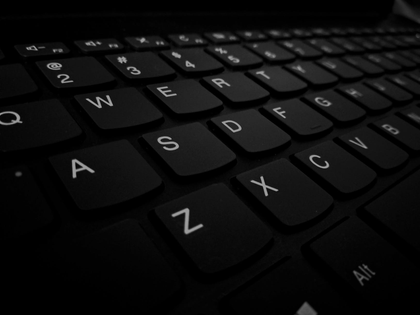 closeup photo of black computer keyboard s left side keys
