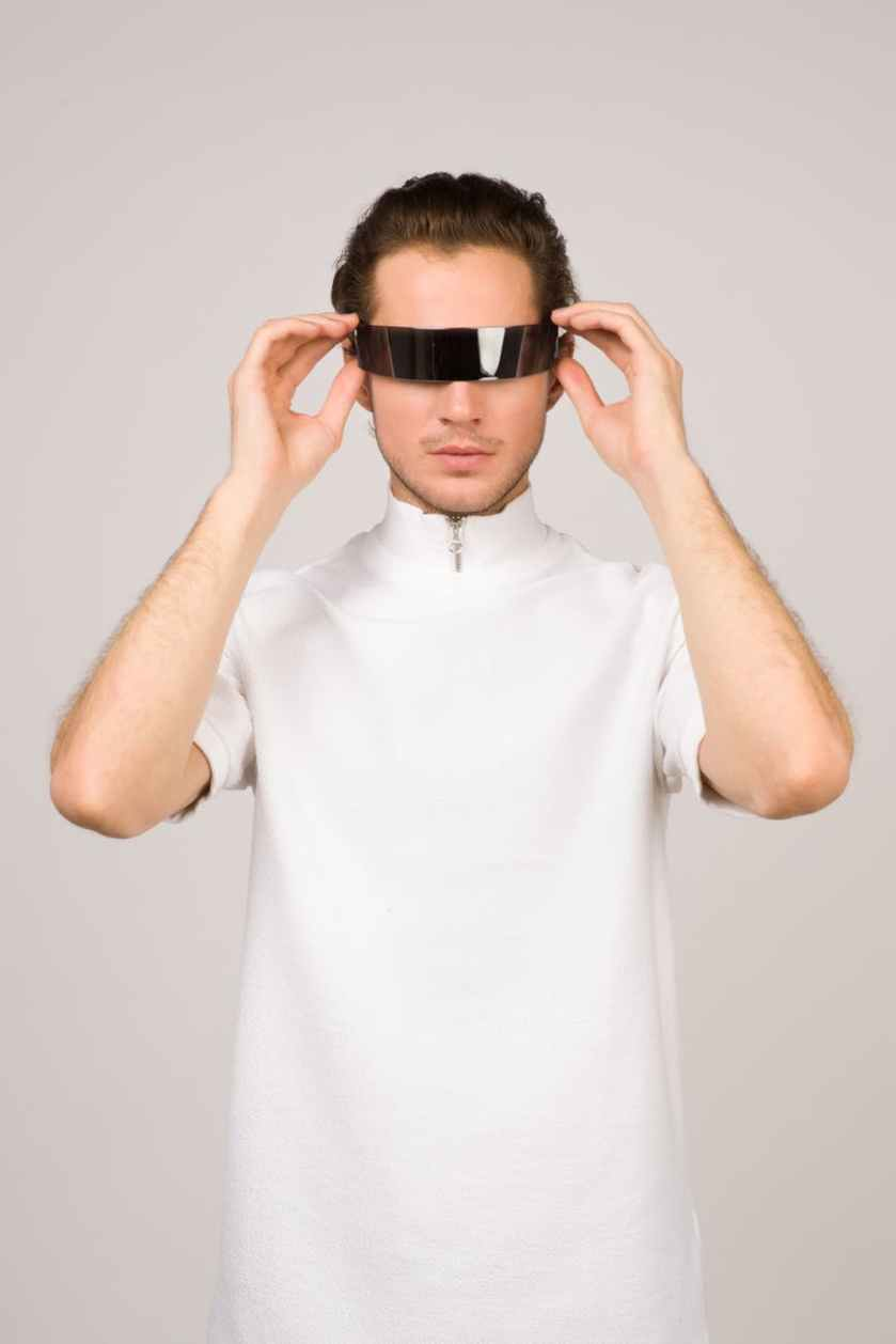 man wearing white turtle neck t shirt